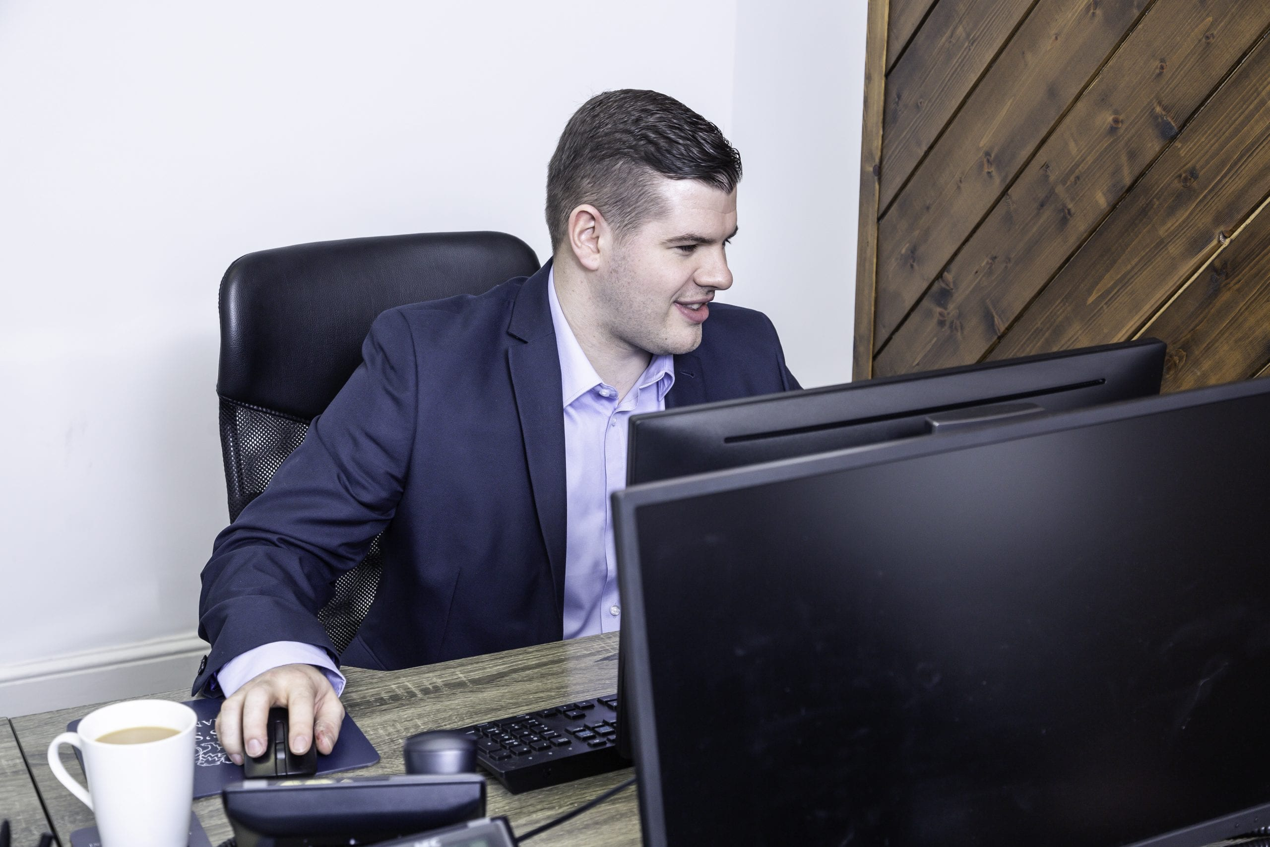 Man working at the front of the computer